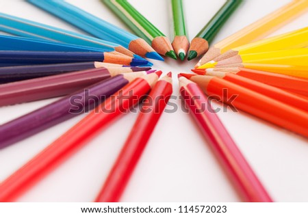 Color pencils in a circle with rainbow colors