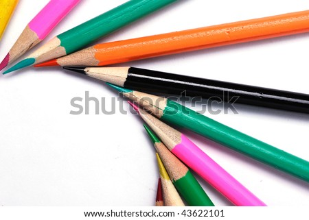 Color pencils in arrange in color wheel colors on white background