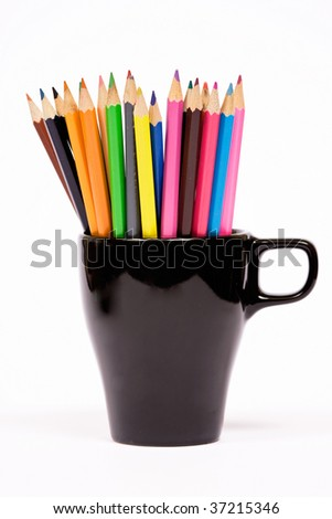 Color pencils in black jar - isolated