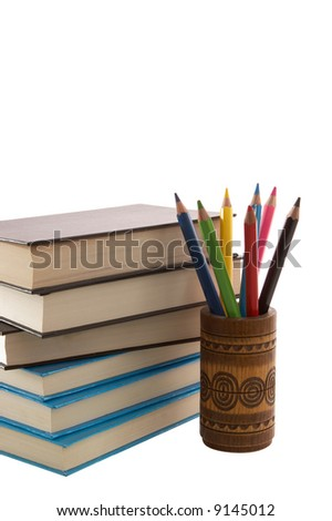Color pencils in box and books. Isolated on white