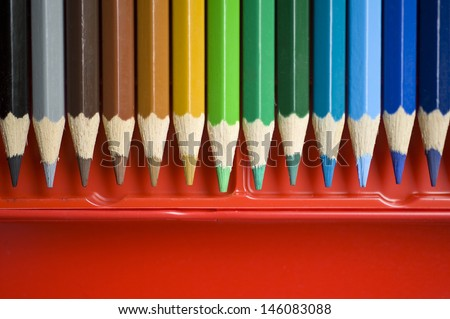 Color pencils in red box.