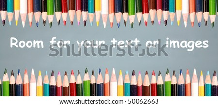 Color pencils on a grey background with room for your text or images