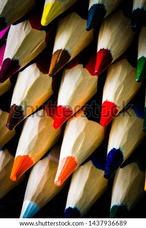 Color PENCILS . Simple composition of colored pencils lying on a flat surface  #1437936689
