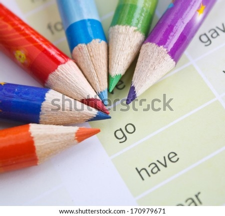 color pencils with inspiration motivation words on paper background