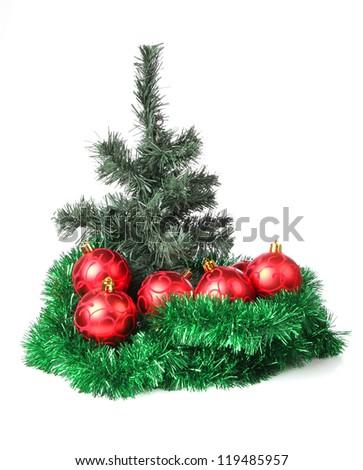 Color photo of a Christmas tree and Christmas toys