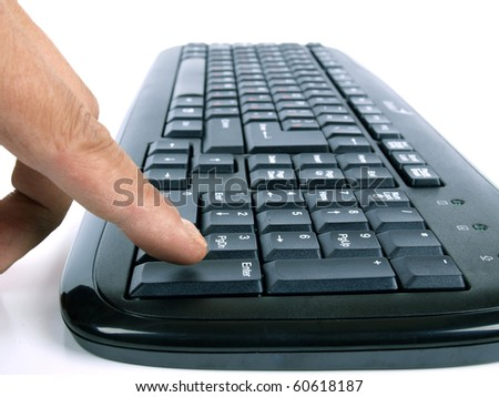 Color photo of a computer keyboard and fingers