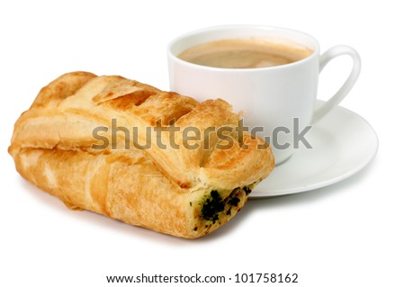 Color photo of a cup of coffee and pastries