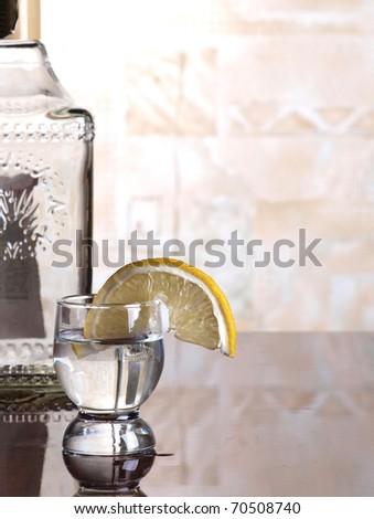 Color photo of a glass cup with tequila
