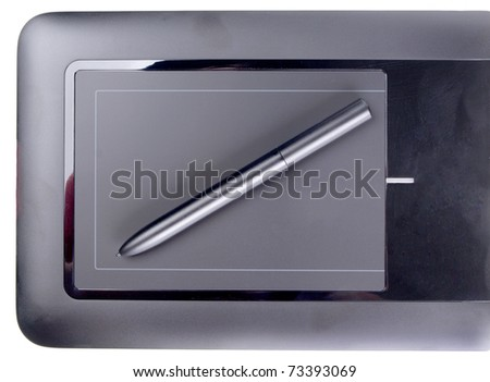 Color photo of a graphic tablet and pen