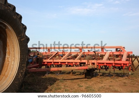 Color photo of a harrow fastened to a tractor