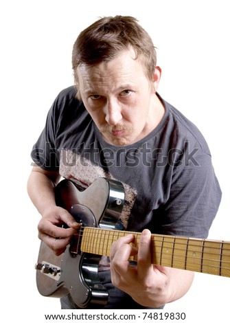 Color photo of a man with an electric guitar in his hands