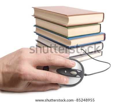 Color photo of an stack books and mouse
