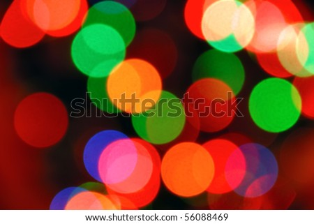 Color photo of blurred Christmas lights at night