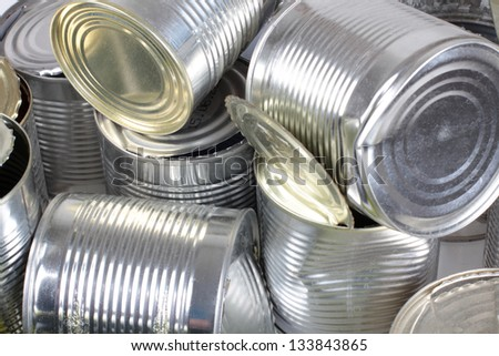 Color photo of metal cans in a landfill