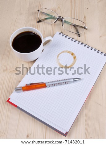 Color photo of paper page and a white cup
