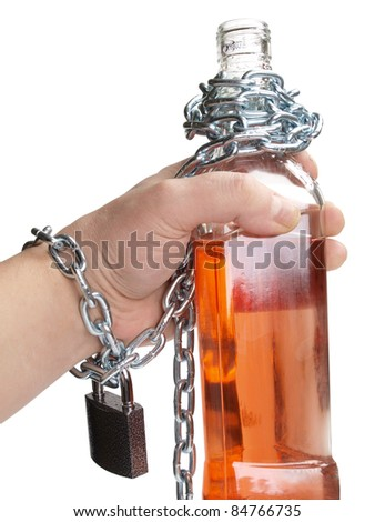 Color photo of wineglass of whiskey and metal chain