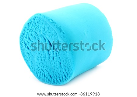 Color plasticine close-up on a white background