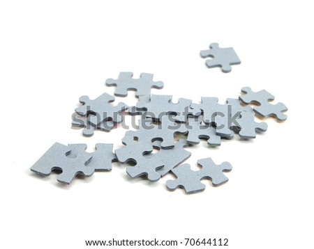 color puzzle pieces on the white background