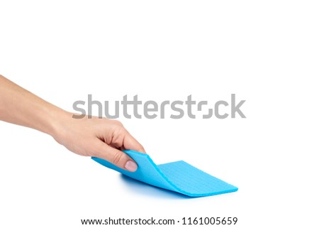 Color rag for domestic cleanse with hand isolated on white background, copy space template. #1161005659