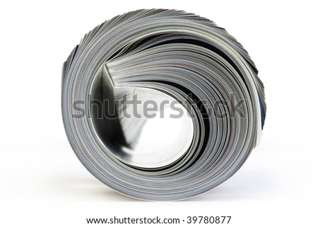 Color, rolled up Magazine. Close-up, front view. Isolated on white background.