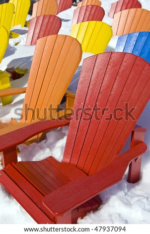 color-seat chairs in the snow