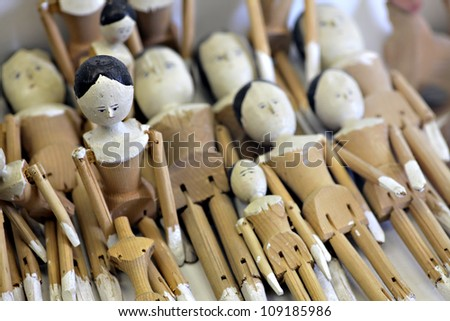 Color shot of a collection of vintage wooden dolls - stock photo