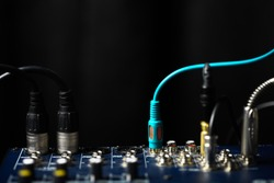 Color shot of many jacks plugged in a mixer