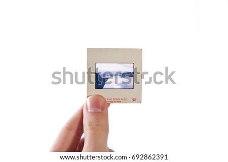 Color slide frame held in hand