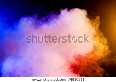 Color smoke on black background