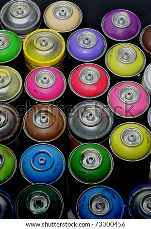 Color spray cans used for graffiti street art.