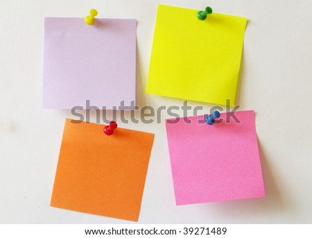 Color sticker notes over white paper background