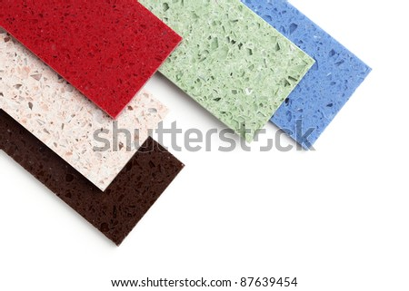 Color stone samples for kitchen worktops on white background.