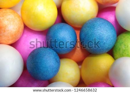 Color Styrofoam balls. Wedding Decorative Polystyrene Spheres Baubles, bright colors background. #1246658632