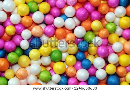 Color Styrofoam balls. Wedding Decorative Polystyrene Spheres Baubles, bright colors background. #1246658638