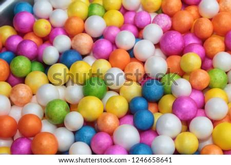 Color Styrofoam balls. Wedding Decorative Polystyrene Spheres Baubles, bright colors background. #1246658641