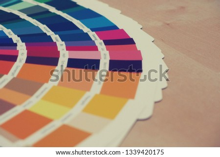 Color swatch book or color chart. Color swatches on the desk. #1339420175