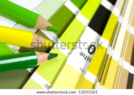 Color swatch book with pencils