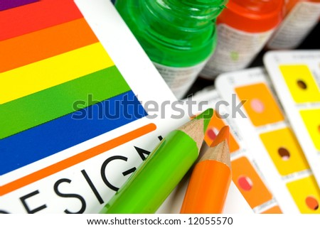 Color swatch book with pencils - stock photo