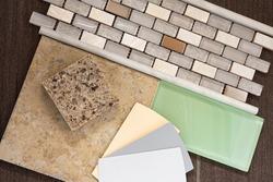 color swatches against tile backsplash countertop floor remnants for bathroom remodel