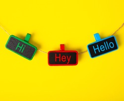 Color tag with the word HI, HEY and HELLO on yellow background