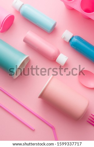 Color textured background made with different  object with pink and pastel color tonality disposed in diagonal path, group of objects aligned