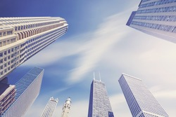 Color toned photo of Chicago skyscrapers with motion blurred clouds, Illinois, USA.