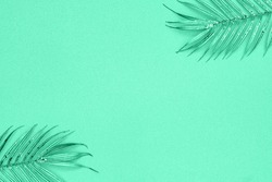 COLOR TREND 2020 Aqua Menthe. Abstract monochrome background in trendy Aqua Menthe cyan mint color toned. Palm glitter golden twigs decorations, text place, copy space