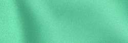 COLOR TREND 2020 Neo mint. Abstract new mint color background. Sea-foam Green satin background. Soft silk fashion background. Green satin fabric texture, banner