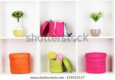 Color wicker boxes on cabinet shelves