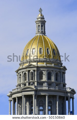 Colorado Capitol in Denver. Close up of gold dome of architecture.