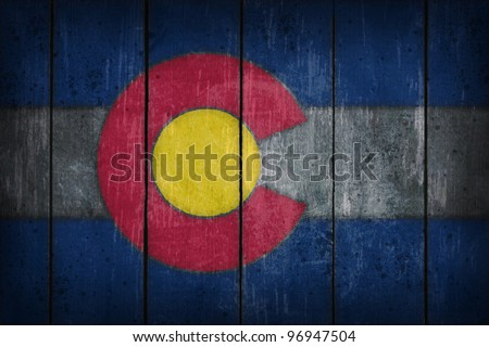 colorado flag on old wooden wound - stock photo