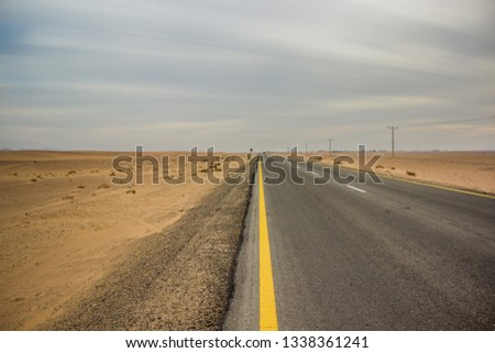 Colorado Plateau in USA desert country side desert natural environment and empty car rural rural road #1338361241