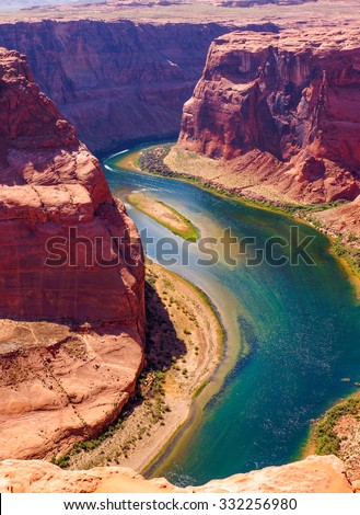 Colorado River cuts through rock at Horseshoe Bend heading for Grand Canyon #332256980