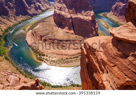 Colorado River cuts through rock at Horseshoe Bend heading for Grand Canyon #395338159